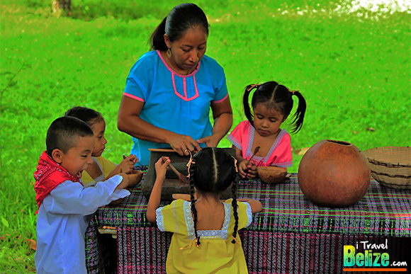 Mayan children helping make chocolate