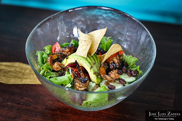 Jerk Shrimp Salad with black beans, frizzled tortillas, veggies and organic garden greens